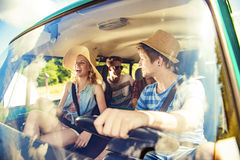 Beautiful young people on a road trip Royalty Free Stock Images