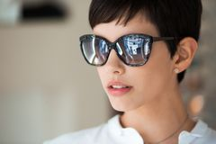 Beautiful young perfect model posing in fashion sunglasses. Portrait of eautiful young perfect model posing in fashion sunglasses Royalty Free Stock Image