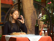 Beautiful Young Peruvian Woman Tasting Wine Royalty Free Stock Photos
