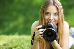Beautiful young photographer Stock Images