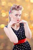 Beautiful young pin up female in stylish polka dot stock photography