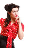 Beautiful young pinup girl thinking, isolated Royalty Free Stock Photography