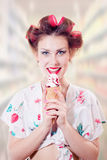 Beautiful young pinup woman eating ice cream cone Stock Image