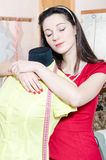 Beautiful young pinup woman with mannequin. Looking tired and exhausted eyes closed Stock Image