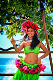 Beautiful young Polynesian Hawaiian woman performing traditional Hula dance Royalty Free Stock Images