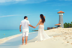 Beautiful young pregnant couple on the Caribbean coast. Royalty Free Stock Images