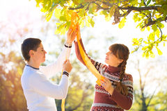 Beautiful Young Pregnant Couple Having Picnic in autumn Park. Ha Royalty Free Stock Photos