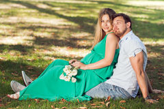 Beautiful young pregnant couple in the park. Beautiful young pregnant couple in nature Stock Photos