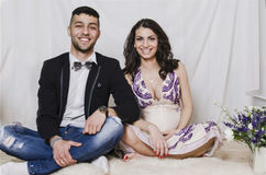 Beautiful young pregnant family Stock Images