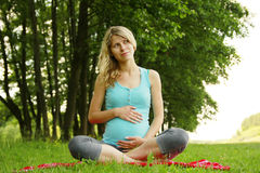 Beautiful young pregnant girl on nature Stock Photo