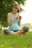 Beautiful young pregnant girl on nature. A beautiful young pregnant girl on nature Stock Image