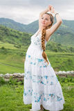 Beautiful young pregnant woman on nature. Portrait of  beautiful young pregnant woman with long braid on nature Stock Images