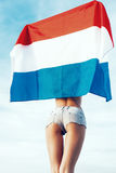 Beautiful young pretty woman with national Dutch flag Stock Image