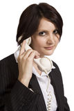 Beautiful young professional woman with old phone Stock Photos