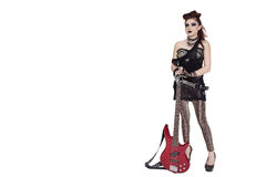 Beautiful young punk woman standing with guitar over white background Stock Images