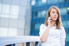 A beautiful young real estate agent woman on the phone Stock Photo