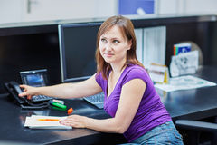 Beautiful young receptionist at work Royalty Free Stock Photography