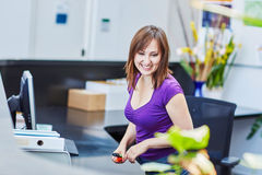Beautiful young receptionist at work Stock Image