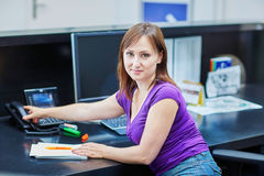 Beautiful young receptionist at work Royalty Free Stock Image