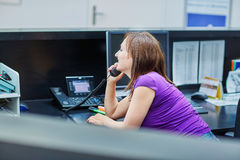 Beautiful young receptionist at work Royalty Free Stock Photo