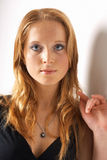 Beautiful young red-haired model. Close-up portrait of a beautiful young red-haired model Stock Photo