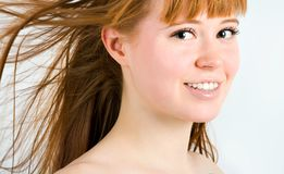 Beautiful young red-haired woman Stock Image