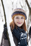 Beautiful young red-haired woman. In winter park Stock Photo