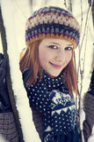 Beautiful young red-haired woman. In winter park Royalty Free Stock Images