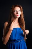 Beautiful young red haired woman Royalty Free Stock Photos