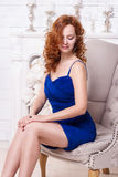 Beautiful young red-haired woman in a blue dress Stock Images