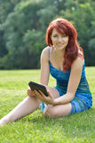 Beautiful young red haired woman outside in summer Royalty Free Stock Photography