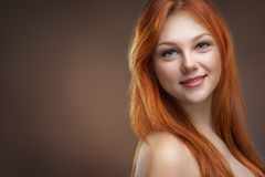 Beautiful young red-haired woman Stock Images
