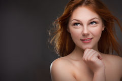 Beautiful young red-haired woman Stock Photo