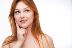 Beautiful young red-haired woman Stock Photos