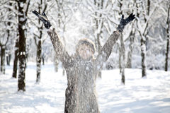 Beautiful young red-haired woman in winter park Royalty Free Stock Photos