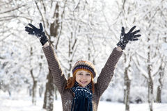 Beautiful young red-haired woman in winter park Stock Images