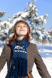 Beautiful young red-haired woman in winter park. Outdoor shot Stock Photos