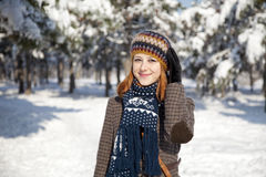 Beautiful young red-haired woman in winter park Stock Photos