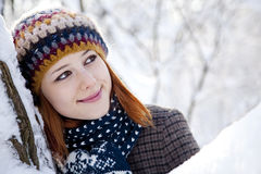 Beautiful young red-haired woman in winter park. Outdoor shot Royalty Free Stock Photos
