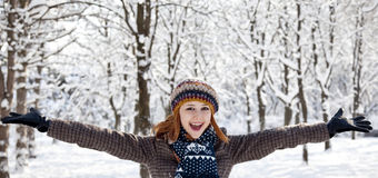 Beautiful young red-haired woman in winter park.  Royalty Free Stock Photos