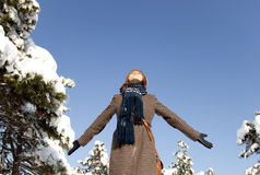 Beautiful young red-haired woman in winter park.  Stock Images