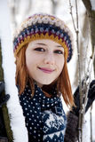 Beautiful young red-haired woman in winter park.  Stock Photography