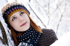 Beautiful young red-haired woman in winter park. Photo #2 Stock Photos