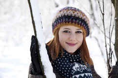Beautiful young red-haired woman in winter park Royalty Free Stock Photo