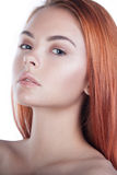 Beautiful young red-head woman with long shiny hair Royalty Free Stock Images
