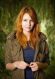 Beautiful young redhead girl outdoors. Stock Photo