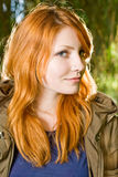 Beautiful young redhead girl outdoors. Royalty Free Stock Photo