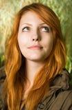 Beautiful young redhead girl outdoors. Stock Photos