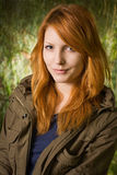 Beautiful young redhead girl outdoors. Royalty Free Stock Image