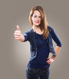 Beautiful young redhead showing thumbs up. Royalty Free Stock Photo